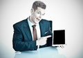 Funny businessman with tablet pc pointing at a modern Royalty Free Stock Image