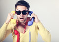Funny call center guy with colorful phones Royalty Free Stock Images