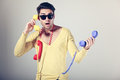 Funny call center men with colorful phones Royalty Free Stock Photography
