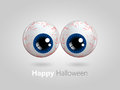 Funny cartoon blue eyes with halloween wishes over grey background Stock Images