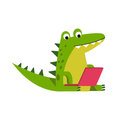 Funny cartoon crocodile character sitting using laptop vector Illustration