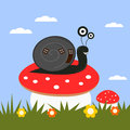 Funny cartoon snail on a toadstool