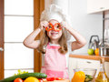 Funny chef girl cook at kitchen cooking Royalty Free Stock Photos