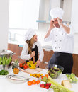 Funny chef master and junior kid girl at cooking school crazy men about pupil recipe Royalty Free Stock Images