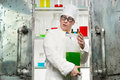 Funny chemist with a bottle in the lab Stock Photos