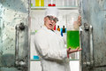 Funny chemist with a bottle in the lab Stock Photo