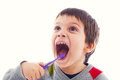 Funny child brushing teeth Royalty Free Stock Photo