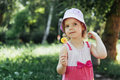Funny child with candy lollipop, happy little girl eating big Royalty Free Stock Photo