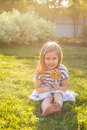 Funny child with candy lollipop, happy little girl eating big sugar lollipop, kid eat sweets Royalty Free Stock Photo