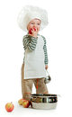 Funny child in chief cook clothes with red apples Stock Images