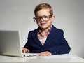 Funny child with computer.Young business boy Royalty Free Stock Photo