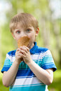 Funny child eating a tasty ice cream outdoors Royalty Free Stock Images