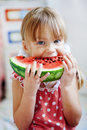 Funny child eating watermelon Stock Photography