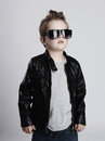 Funny child.fashionable little boy in sunglasses.stylish kid in leather Royalty Free Stock Photo