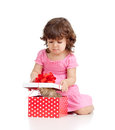 Funny child girl with kitten in gift box Stock Photo