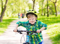 Funny child learns to ride a bike