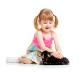 Funny child playing with Scottish kitten Stock Image