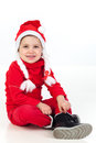 Funny child wearing red christmas hat Royalty Free Stock Photo