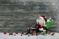 Funny christmas greeting card with santa claus and xmas presents Royalty Free Stock Photo