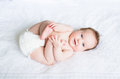 Funny chubby baby playing with its feet Royalty Free Stock Photo