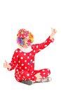 Funny circus clown sitting ang giving thumbs up Royalty Free Stock Image