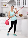 Funny cleaning woman in home after the beautiful young happy having fun by playing air guitar with the mop Royalty Free Stock Photo