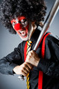 Funny clown with bat Stock Photography
