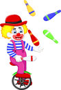 Funny clown cartoon playing balls on bicycle Royalty Free Stock Photo