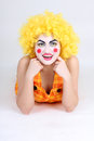 Funny clown in costume and make-up Stock Photography