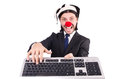 Funny clown with keyboard isolated on white Royalty Free Stock Photography