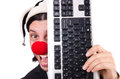 Funny clown with keyboard isolated on white Royalty Free Stock Photos
