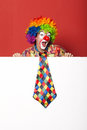 Funny clown with tie on blank white board Stock Image
