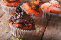 Funny colorful Halloween cupcakes decorated with chocolate hat Royalty Free Stock Photo