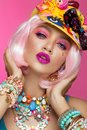 Funny comic girl with bright make-up in the style of pop art. Creative image. Beauty face. Royalty Free Stock Photo