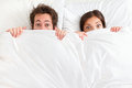 Funny couple in bed Royalty Free Stock Photography