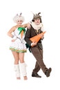 Funny couple carrot dressed as rabbits isolated white Royalty Free Stock Photography