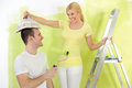 Funny couple painting their home Stock Photo