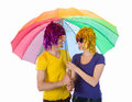 Funny couple with wigs sunglasses and umbrellas colorful umbrella isolated over white Royalty Free Stock Photo