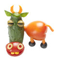 Funny cow made of vegetables on isolated background Stock Photo