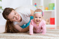 Funny crawling baby girl with mother Royalty Free Stock Photo