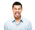 Funny crazy face man mixed race latino Stock Photo