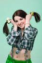 Funny cute smiling woman pigtails green background Royalty Free Stock Photos