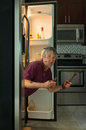 Funny dirty appliance repair homeowner man in refrigerator Royalty Free Stock Photo