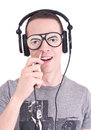Funny dj young man with headphones and stupid sunglasses studio shot Stock Photo