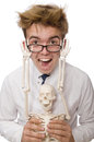 The funny doctor with skeleton isolated on white Royalty Free Stock Photo