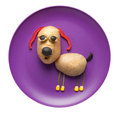 Funny dog made of vegetables on plate Royalty Free Stock Photo