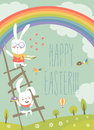 Funny easter bunnies with rainbow