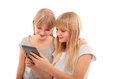 Funny ebook young females reading something in an reader tablet device Royalty Free Stock Photos