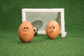 Funny eggs and football goal and envy egg Royalty Free Stock Images
