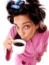 Funny and expressive young woman portrait drinking coffee in the morning drinking coffee after wake up Stock Images